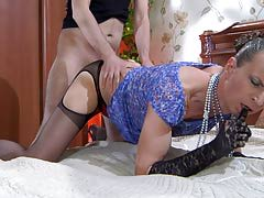 Dressed like a lady sissy putting his mouth and rear to work in man-on-man