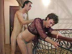 Lewd sissy in a see-through blouse swallowing a hard cock and ass riding
