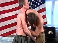 Young army soldiers enjoy oral sex
