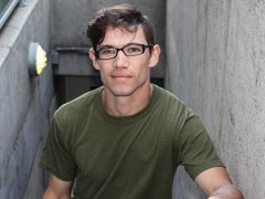 Bud is a lean circumcised young man wearing glasses which gives off a great sex appeal