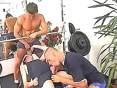 Sporty cute gays suck each other in group