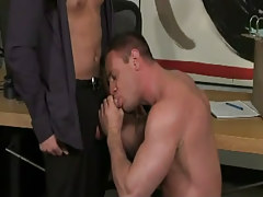 Muscle gay sucks hard cock in office