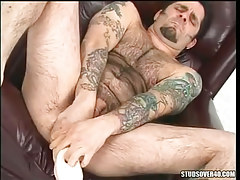 Hairy gay deep pushes big toy in asshole