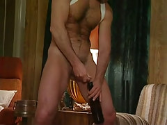 Hairy gay pissing in bottle after blowjob