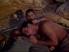 Muscle gay sucks cock in cave
